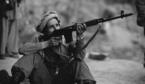 Ahmed Shah Massoud Firing a Rifle